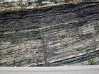 Pound Gap where the lower portion of the thin bedded Mississippian Grainger Formation is composed of alternating thin sands and shale and the overlying middle portion is composed of varying thicknesses of sand separated by bedding planes marked by thin shale