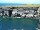 Atlantic margin of Loop Head Co Clare exposing mid to distal sparsely channelled deepwater fan sheets.