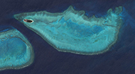 NASA satellite image of Heron Reef and the eastern end of Wistari Reef in the southern Great Barrier Reef, Australia.